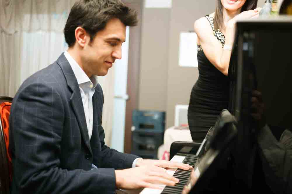 Man playing piano for his girlfriend