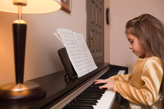 child's first piano lesson