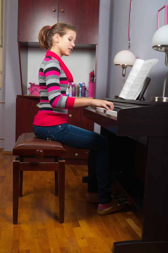 gril playing on piano