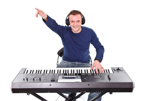 man with headphones and keyboard